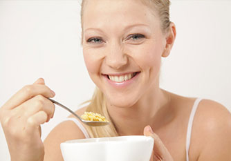 Woman-Eating-Cereal - Trapped Food Causes Oral Problems in South Jordan, UT