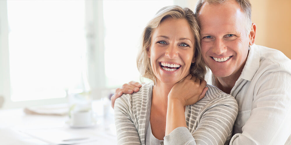 Wife and husband perfect smile - family dentistry South Jordan